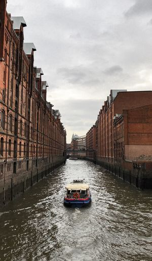"""""""Speicherstadt"""" in Hamburg, Germany. Hope you enjoy it 😊 Vacations Holidays Traveling Clouds Boat Speicherstadt Hamburg Germany Hamburg Water Blue Blue Sky Sky Transportation Cloud - Sky Mode Of Transportation Architecture Built Structure Nature City Street Travel Day"""