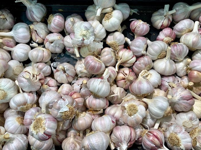 Garlic Bulb Garlic Full Frame Backgrounds Large Group Of Objects Abundance No People Freshness Close-up Food Food And Drink Day For Sale Still Life Nature Market Ingredient