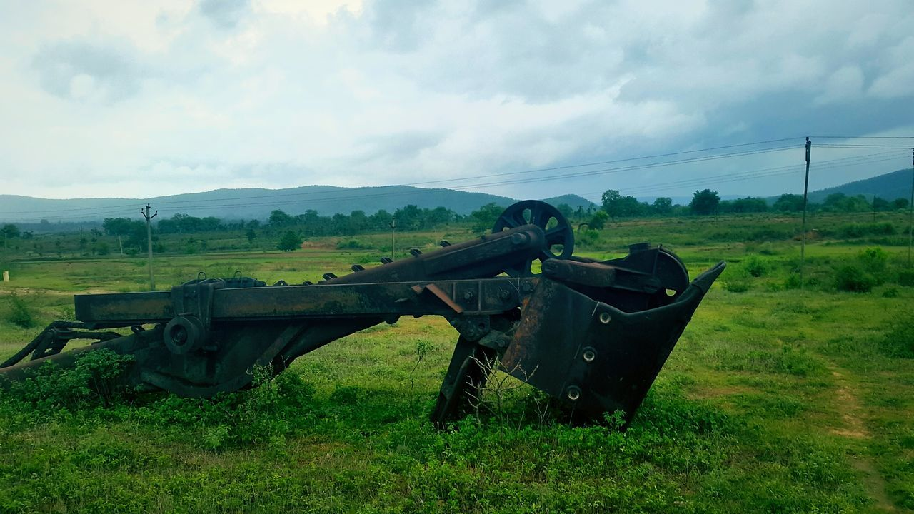 history, field, weapon, grass, old, landscape, sky, canon, cannon, cloud - sky, military, day, green color, no people, abandoned, war, old-fashioned, outdoors, nature, scenics, beauty in nature, airplane, army