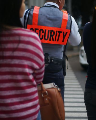 Accidents And Disasters Emergency Services Occupation People Rear View Police Force Protective Workwear Outdoors Security Traffic Enforcer Pedestrian