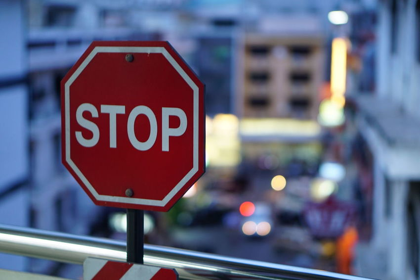 Stop what? Stop Sign Text Red Communication Warning Sign Transportation Focus On Foreground Road Sign Guidance Day Built Structure Close-up Architecture No People Outdoors Building Exterior City Sky Platform Station Platform Indoors  Caution Sign Metro Station Caution