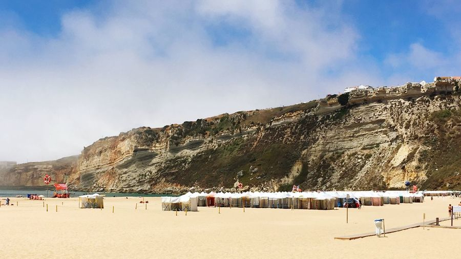 Cliffs of Nazare with beach huts Beach Beach Tent Beach Life Sky Land Sand Group Of People Cloud - Sky Crowd Holiday Vacations Water Sunlight Trip Nature
