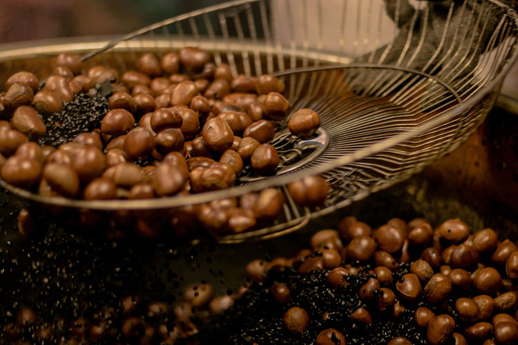 Close-up of chestnut roasting in container