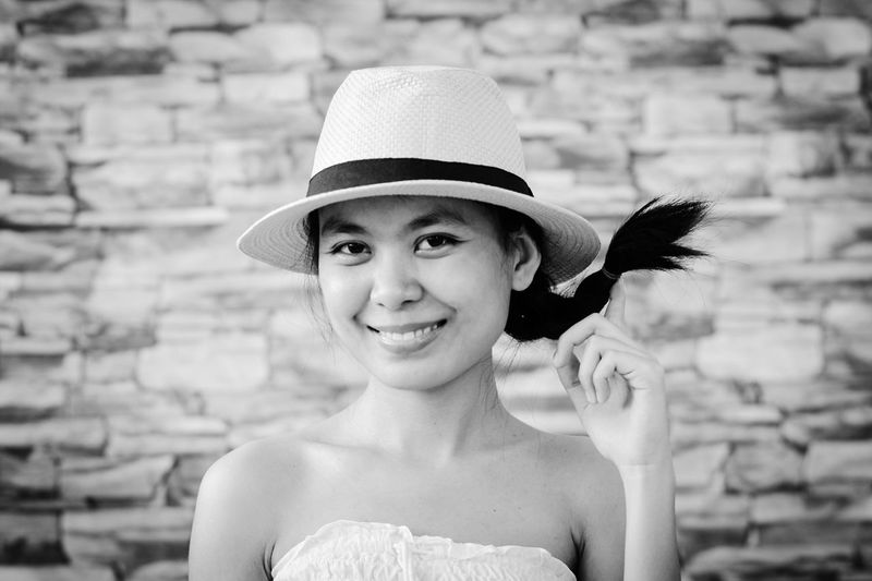 Hat Real People Looking At Camera Portrait One Person Childhood Smiling Happiness Outdoors Focus On Foreground Day Sun Hat Young Adult Young Women Close-up The Portraitist - 2017 EyeEm Awards Live For The Story Place Of Heart Live For The Story