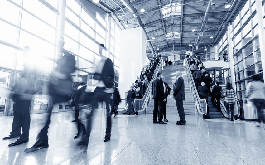 Blurred Motion Of People Walking At Airport
