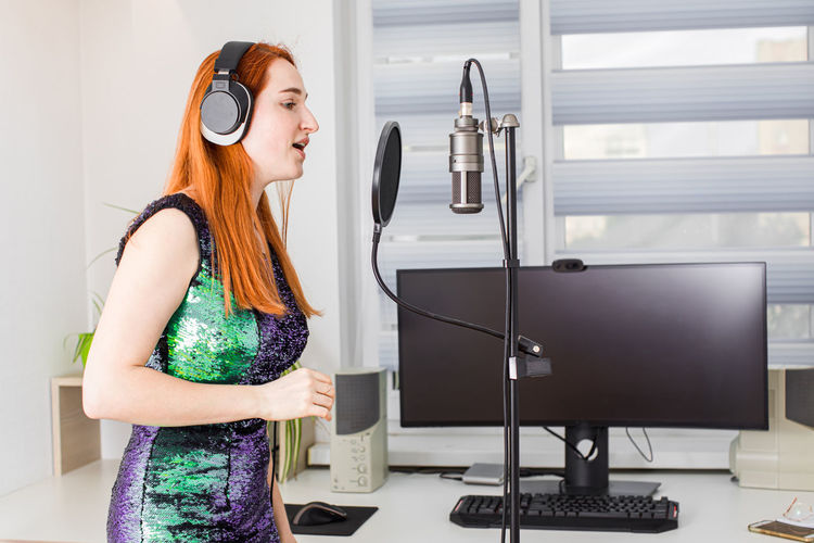 Side view of woman in recording studio
