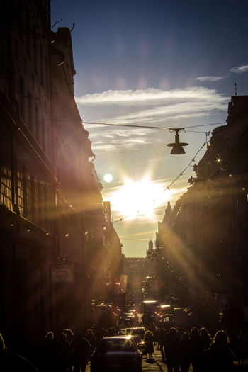 Boulevard Shopping Stockholm, Sweden Sundowner Sunlight Architecture Building Exterior Built Structure City City Life Cityscape Crowd Day Flag Flanieren Large Group Of People Lens Flare Outdoors People People And Places Shopping Street Sky Street Sun Sunset