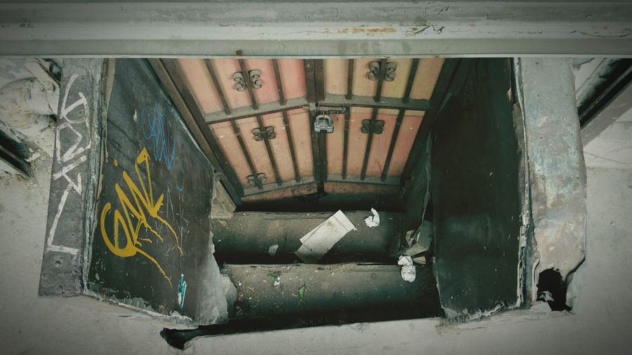 Down these steps and down a lightly lit hall and at the very end inside a hole in the floor is a vendor of purses, watches and anything else who can think of that can be pirated. NYC NYC Photography Door Hallway Creepy Notchinatown Midtown Photographer Fhmmg Taking Pictures