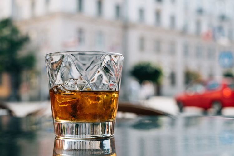 glass of whiskey on the terrace Beverage Beverages Copy Space Paris Architecture Building Exterior Close-up Delicious Drink Drinking Glass Drinks After Work Focus On Foreground Freshness Glass No People Outdoors Refreshment Streetphotography Whiskey