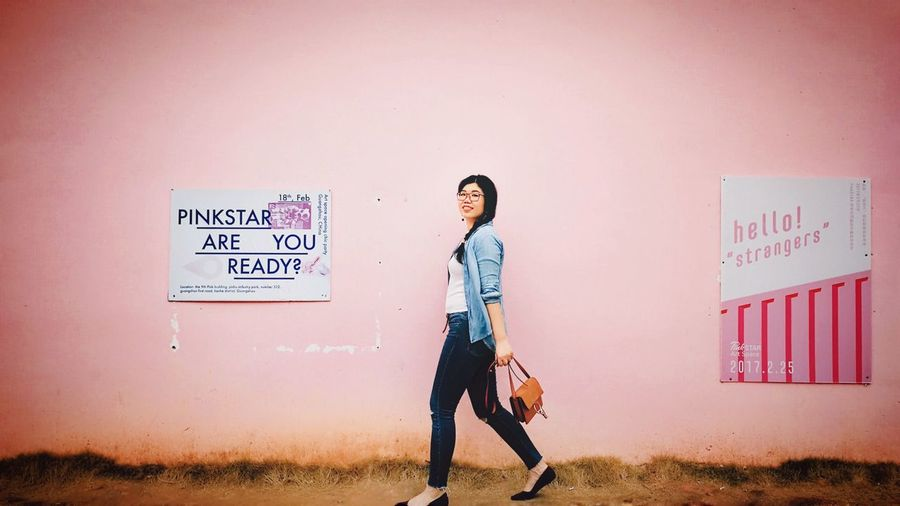 Pink Wall ♡♥♡ Text One Person Communication Wall - Building Feature Full Length Western Script Young Adult Casual Clothing Lifestyles Standing Built Structure Leisure Activity Sign