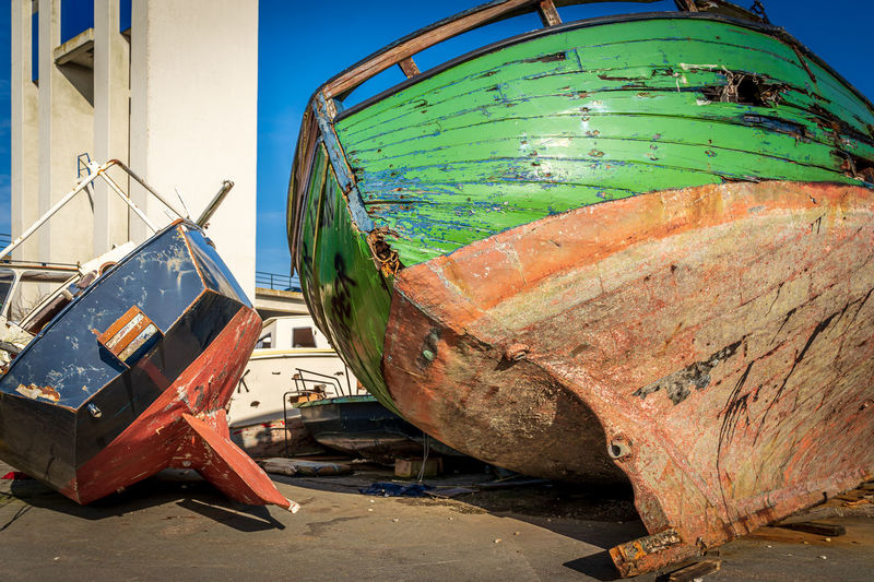 Close-up of abandoned boat moored