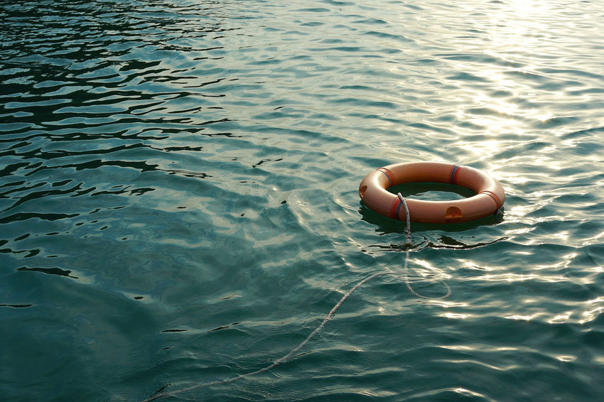 Rescue ring Buoy Buoy On The Water Day Floating On Water Lifebuoy Nature No People Outdoors Rescue Rippled Sea Seawater Water Waterfront