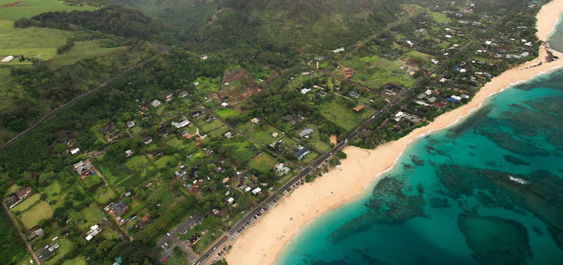 Aerial View Of Sea And Green Landscape
