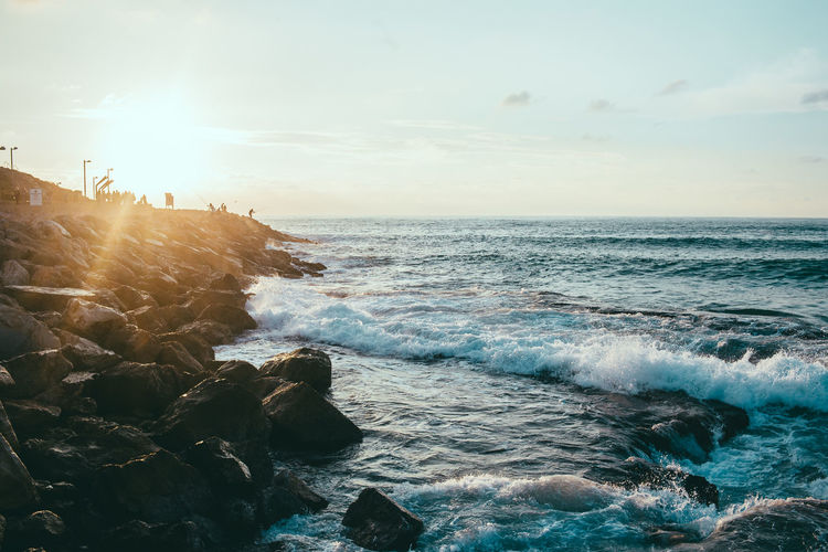 Sunset in Tel Aviv Sea Water Sky Rock Rock - Object Wave Solid Beauty In Nature Scenics - Nature Horizon Over Water Motion Horizon Beach Land Sport Nature Aquatic Sport Surfing Non-urban Scene Outdoors Power In Nature Breaking Flowing Water Rocky Coastline