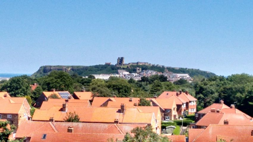 The Castle on the Hill. Scarborough. June 2017. Building Exterior Architecture Roof Built Structure Town Outdoors Day Tree Blue No People Community City Sky Tiled Roof  Nature Cityscape Tranquil Scene Full Frame Dramatic Sky Scenics Beauty In Nature Nature Tranquility Travel Destinations Landscape