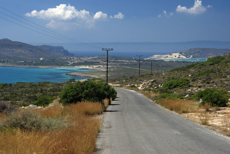 Strada per Simos Beach Summer Water Driving Travelling Holiday Travel Panorama Road Island Greece Waterfront Greek Islands Elafonisos Travel Destinations Peloponneso Peloponnese Greece Elafonissos Transportation Sky Cloud - Sky Plant Cable Nature Connection The Way Forward Day Electricity  Technology Direction Scenics - Nature Power Line  Mountain No People Land Beauty In Nature Electricity Pylon Outdoors Diminishing Perspective Power Supply Telephone Line