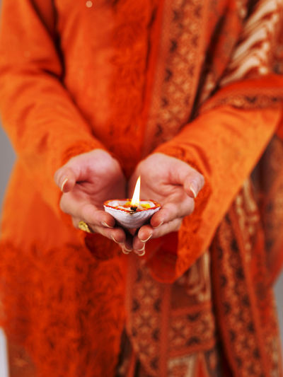 malay lady holding indian oil lamp Burning Celebration Diwali Flame Indian Culture  Light Tradition Traditional Clothing Woman Baju Kurung Close Up Colorful Cultural Deepavali  Diya - Oil Lamp Female Festival Festive Of Lights Holding Illuminated Indian Festive Season Malay Mix Culture Oil Lamp United