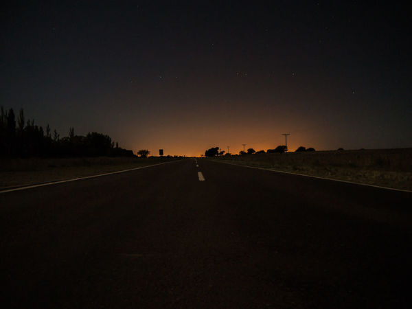 Beauty In Nature Copy Space Dark Diminishing Perspective Direction Environment Field Land Landscape Nature Night Non-urban Scene Outdoors Road Scenics - Nature Silhouette Sky Sunset The Way Forward Tranquil Scene Tranquility Transportation