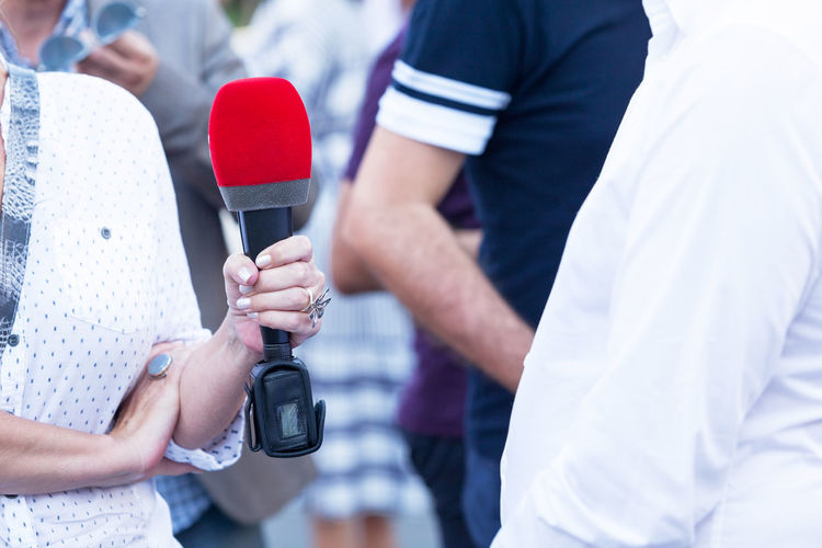 Female reporter making media interview Interview Interviewing Media Interview Media The Media Press Journalism Journalist Reporter Reporting Communication Public Relations Publicity Publicimage Recording Microphone Information Talking Question Q&A Broadcasting Conversation One On One Public