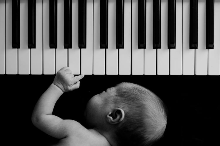 Baby sleeping by piano