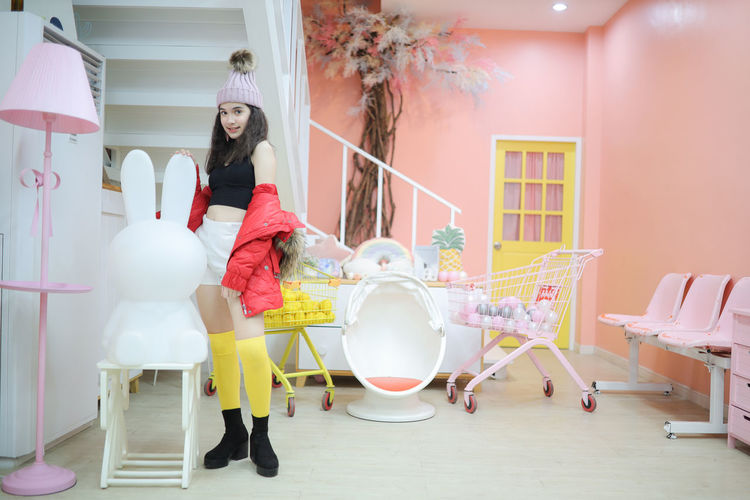 Girl standing on table at home