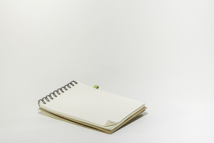 Close-up of note pad on white background
