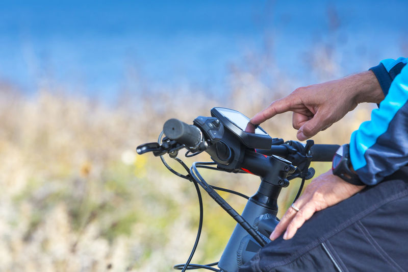 Close-up of hand using equipment on bicycle handlebar