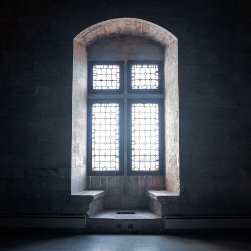A window in the Palais des Papes, Avignon EyeEmNewHere Palais Des Papes Solemn Architecture darkness and light Glass - Material Indoors  Light And Shadow Medieval Medieval Architecture Medieval Castle Old Religion Spirituality Symmetry Window The Still Life Photographer - 2018 EyeEm Awards The Architect - 2018 EyeEm Awards