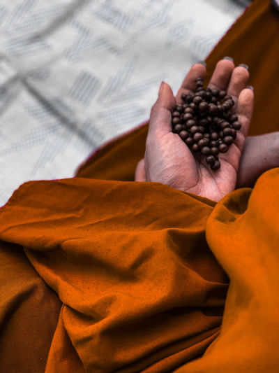 A monk with his mala prayer beads