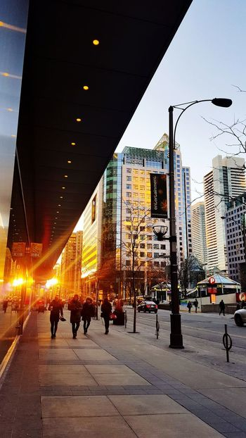 Everyone's more relaxed on Friyay Buildings Toronto The 6ix Sunset Late Winter Sunset Pedestrians Commuters Downtown Street Wellington  Firy Sunset City City Life Architecture Outdoors Built Structure Building Exterior People Sky