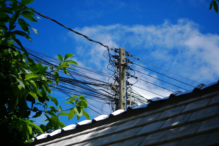 Low angle view of telephone pole against sky