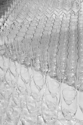 Glasses in triangular order Champagne Event Glasses Party Time! Rules Setting Alignment Arrangement Catering Clean Drink Elements Gastronomy Glass Monochrome Order Party Row Set-up Sparkling Wine System Table Tidiness Triangular Welcome