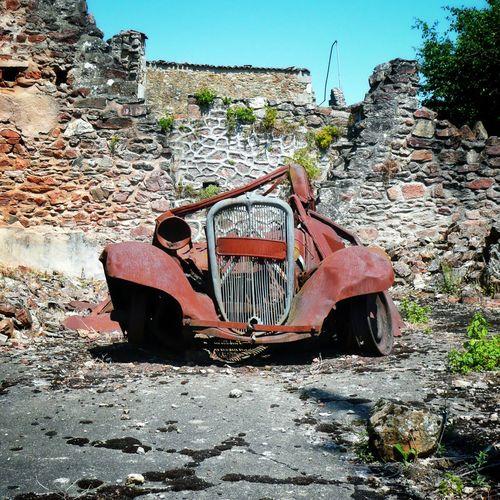 A rusting Citroen car at Oradour-sur-Glane France. Abandoned France Oradour Sur Glane First Eyeem Photo