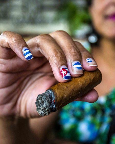 Enjoying Cuban cigar in Havana, Cuba. Havana, Cuba Caribbean Life People Cigarphotography Cigarporn Cigarlovers Streetphotography Cubancigar Cuban Flag Cubanlife City Life Beauty BestDestinatonSoFar Fashion&love&beauty