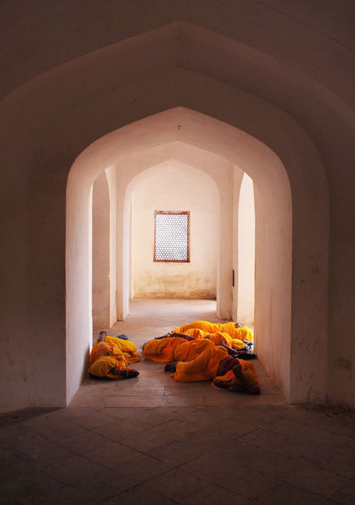 Ladies napping in India Delhi India Indian Culture  Jaipur Ladies Light Nap Time Napping Rajasthani Arch Architecture Group Indoors  Nap Orange Color People Of India Rajasthan Rest Robes Sleeping Sleeping Cat Temple Women women around the world