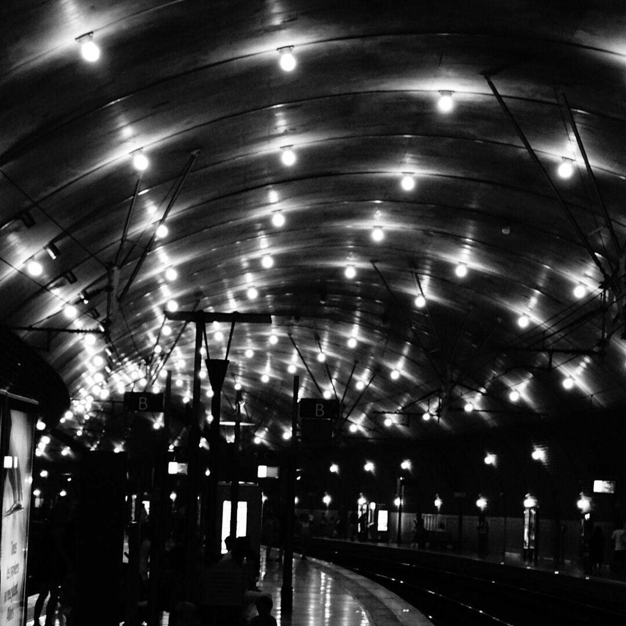 illuminated, night, transportation, ceiling, railroad station, indoors, rail transportation, travel, railroad station platform, built structure, architecture, modern, city, no people