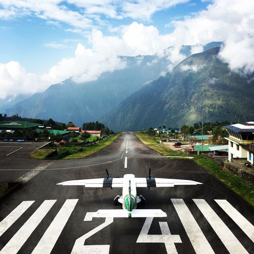 Ready for Takeoff Himalayas The Traveler - 2018 EyeEm Awards Airport Asphalt City Cloud - Sky Communication Dangerous Airport Day Direction Lukla Airport Marking Mountain Mountain Range Nature No People Outdoors Road Road Marking Sign Sky Symbol The Way Forward Transportation Travel