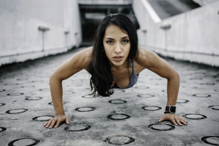Portrait of young woman exercising