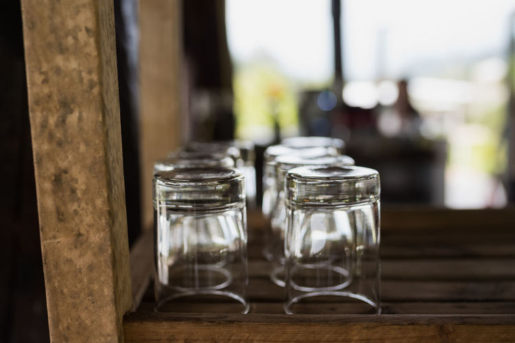 Close-up of empty upside down glasses on wooden table