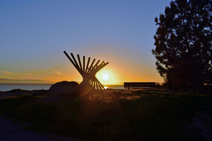 Sunset @ Oyster Bay Pt 3 San Leandro,Ca. Stainless Steel Sculpture Rising Wave 16 Poles Artist: Roger Berry All About Angles Sun Rays Sunset Silhouettes Sunset Collection Scenic Pier Vista Wooden Bench Boulder Marin Headlands San Francisco Bay Sunset Photography Vista Landscape_Collection Landscape_photography Sun Over The Horizon Nature Beauty In Nature Hilltop Landscape