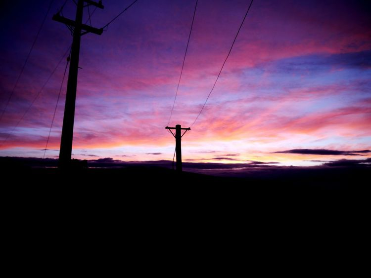 Another angle of my colored sky. Love the sunsets in NZ Silhouette Sunset Electricity Pylon Landscape Rural Scene No People Sky Outdoors Nature Day Sunset_collection Sunsets Clouds
