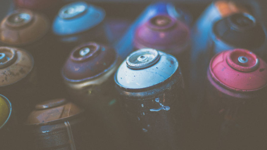 Full Frame Shot Of Old Spray Bottles