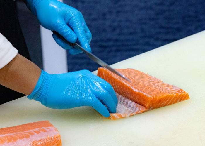 chef slicing raw fresh salmon, Chef preparing a fresh salmon on a cutting board Chef Salmon Fish Raw Board Food Fresh Knife Kitchen Cutting Hand Cut Sushi Seafood Slicing Japanese  Sashimi  Table SLICE Gourmet Fillet Professional Cooking Restaurant Healthy Ingredient Cuisine Meal Preparation  Piece Closeup Meat Cook  person Preparing Red Natural Dish White Man Background Orange Prepare Dinner Eat Health Work Nutrition Sharp Freshness
