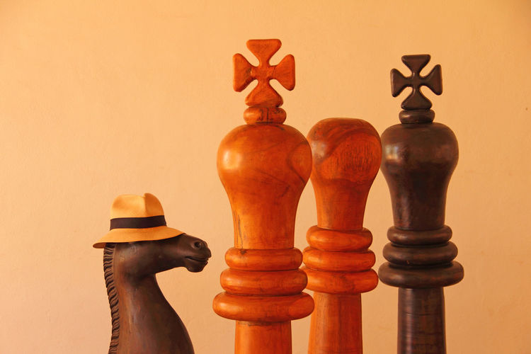 Close up of wooden chess pieces against beige background