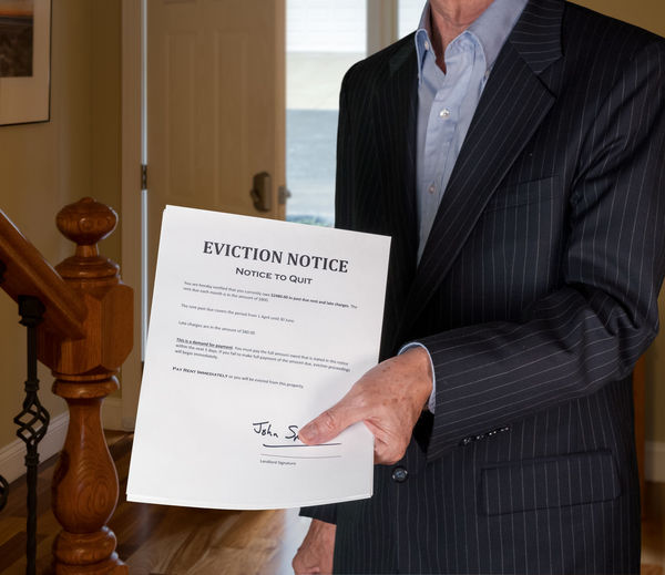 Midsection of man holding paper at home