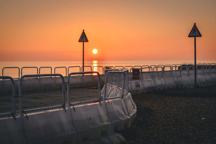 Evening on the beach in Brighton. Street Signs Beach Evening Magic Nature No Cycling No Pedestrians No People Orange Color Scenics Sea Sky Sun Sunset Water Wooden Pathway