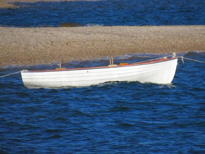 Sailboat moored on sea
