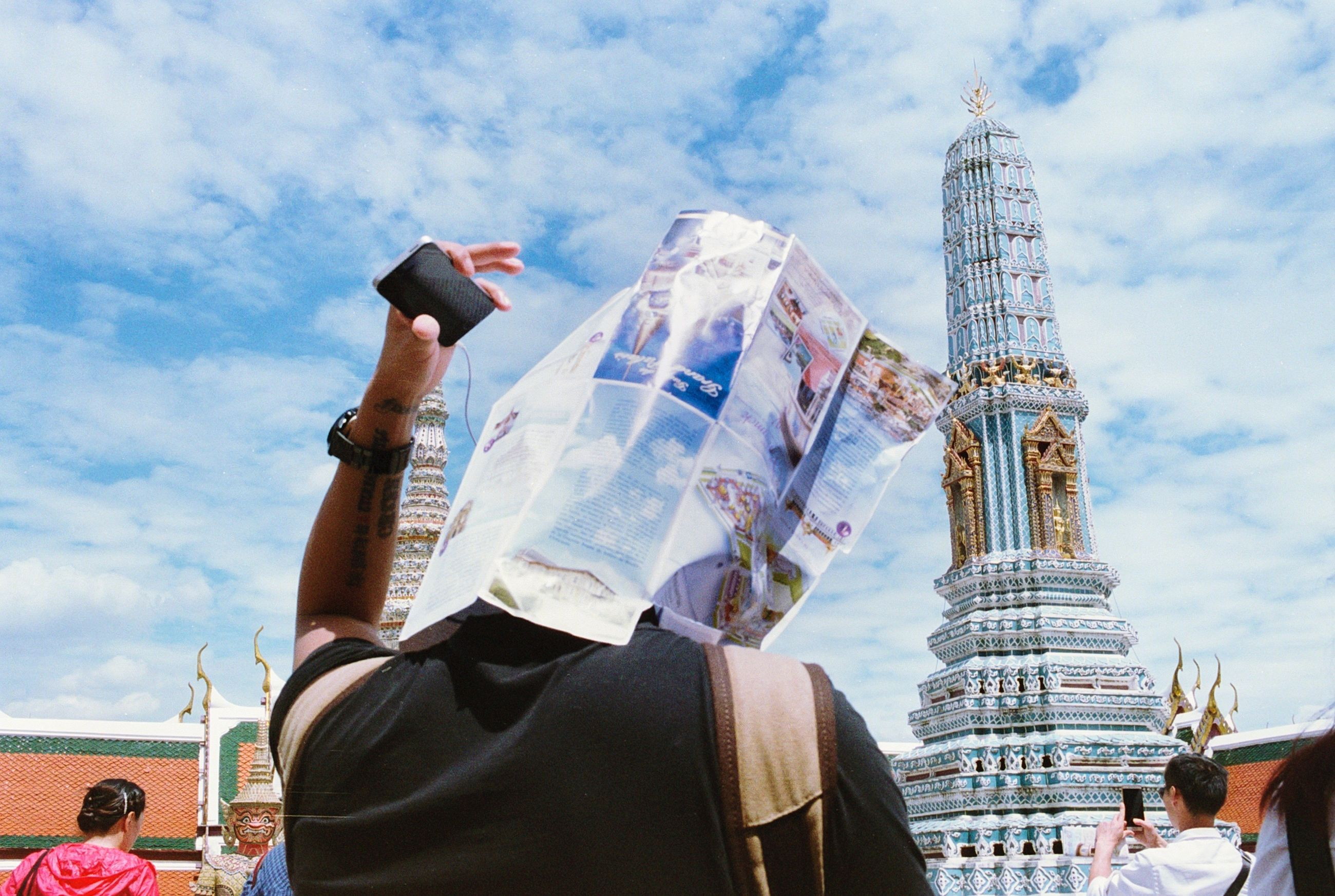 LOW ANGLE VIEW OF WOMAN STANDING AGAINST EIFFEL TOWER