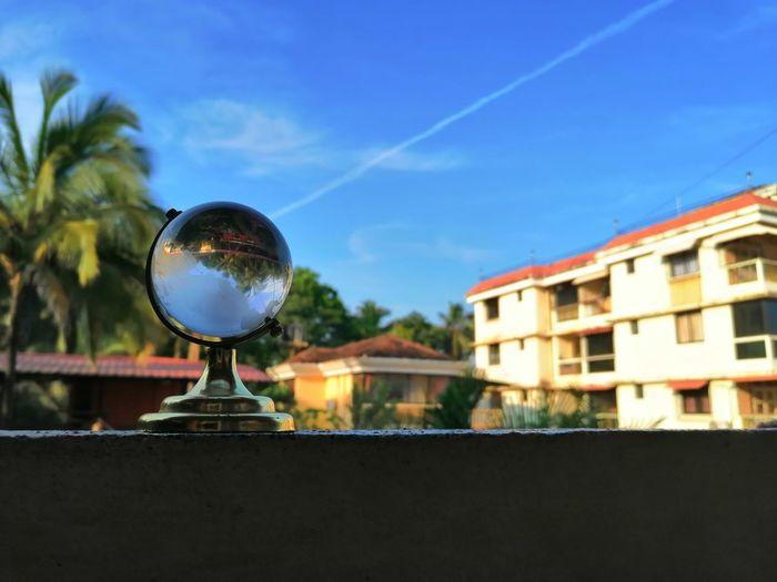 Glass globe EyeEm Best Shots EyeEm Diversity Reflection Glass Ball Photography Closr Up Blue Sky Cristal Cristal Photography City Cityscape Sky Architecture Residential Structure