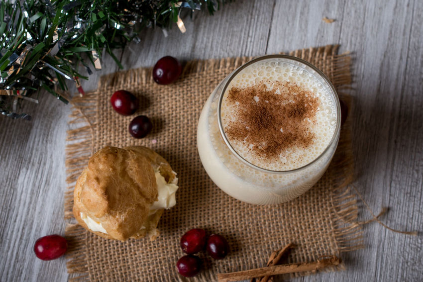 Top view of egg nog and cream puff on a burlap napkin Burlap Cream Puff Past Christmas Drink Egg Nog Food And Drink Glass High Angle View No People Sweet Food